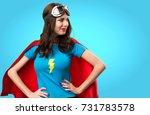 pretty superhero girl looking... | Shutterstock . vector #731783578