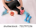 sporty woman with bowl of... | Shutterstock . vector #731797156