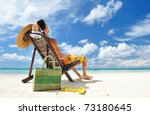 man on a tropical beach with hat | Shutterstock . vector #73180645