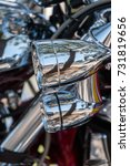 Small photo of Close view detail of the shiny details of a classic motorcycle.