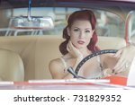 a pinup model posing with a... | Shutterstock . vector #731829352