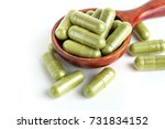 moringa capsules on wooden... | Shutterstock . vector #731834152