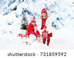 children with christmas tree on ... | Shutterstock . vector #731859592