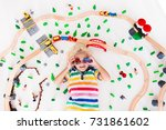 kids play with toy train... | Shutterstock . vector #731861602