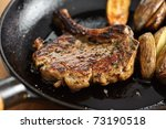 Porkchop in pan - stock photo