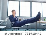 man sitting in office with legs ... | Shutterstock . vector #731910442