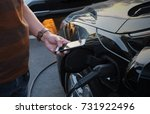 a man at the power supply for... | Shutterstock . vector #731922496