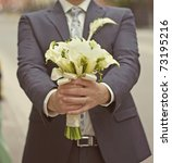 the groom is holding a wedding... | Shutterstock . vector #73195216