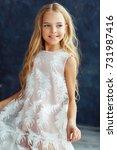 beautiful girl with wavy hair... | Shutterstock . vector #731987416