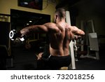 man working out shoulders in a... | Shutterstock . vector #732018256