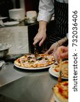 chef cutting pizza with the... | Shutterstock . vector #732036406