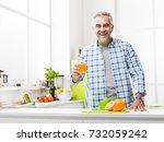 smiling man having breakfast at ... | Shutterstock . vector #732059242