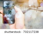 image of a biker texting on a... | Shutterstock . vector #732117238