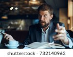 business man with a beard  cafe ... | Shutterstock . vector #732140962