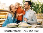 happy family is enjoying pasta... | Shutterstock . vector #732155752