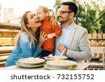 happy family is enjoying pasta... | Shutterstock . vector #732155752