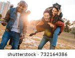smiling multicultural friends... | Shutterstock . vector #732164386