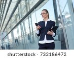 girl in a business suit and... | Shutterstock . vector #732186472
