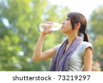 woman drink water after sport | Shutterstock . vector #73219297