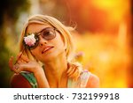 a girl in sunglasses is holding ... | Shutterstock . vector #732199918