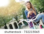 cheerful girl with city bike in ... | Shutterstock . vector #732215065