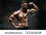 naked strong man showing his... | Shutterstock . vector #732263638
