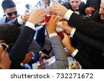 men clang their glasses and... | Shutterstock . vector #732271672