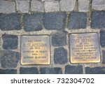 Small photo of BERLIN GERMANY 09 22 17: A stolperstein stumbling stone or stumbling block is a cobblestone concrete cube bearing a brass plate inscribed with the name of victims of Nazi extermination or persecution.