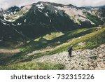 man hiker trekking in mountains ... | Shutterstock . vector #732315226
