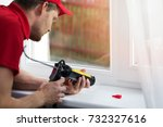 worker applying silicone...   Shutterstock . vector #732327616