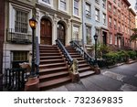 A Row Of Colorful Brownstone...