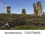 Small photo of Detached granite rocks of unusual shape on the dais. Ridge Ulakhan-Sis. Yakutia. Russia.