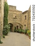 Small photo of Stone arches at passageway in the medieval village of Monells, Girona, Catalonia, Spain.