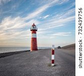 red and white lighthouse in... | Shutterstock . vector #732439756