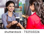 indian woman customer paying... | Shutterstock . vector #732510226