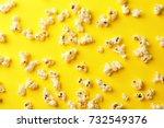 scattered popcorn on color...   Shutterstock . vector #732549376