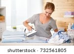 happy woman housewife ironing... | Shutterstock . vector #732561805