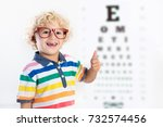 child at eye sight test. little ... | Shutterstock . vector #732574456