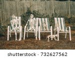 Family of skeletons sits on...