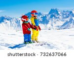 child skiing in the mountains.... | Shutterstock . vector #732637066
