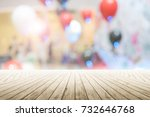 empty wooden table with party... | Shutterstock . vector #732646768