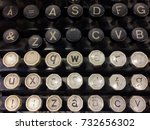 Small photo of Finnish grungy old vintage typewriter including uppercase and lowercase letter Å with ring, letters Ä and Û with diaereses, combining diaeresis (¨), QWERTY, and ASDF keys.