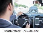 asian man driving car | Shutterstock . vector #732683422