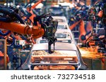 the arm of a car production line | Shutterstock . vector #732734518