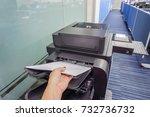 close up woman hand put paper... | Shutterstock . vector #732736732