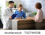 receptionist and doctor with... | Shutterstock . vector #732744538