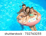 happy family with inflatable... | Shutterstock . vector #732763255