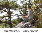 woman meditating in mountains...   Shutterstock . vector #732773992