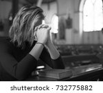 woman praying in the church... | Shutterstock . vector #732775882