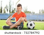 cute boy with soccer ball on... | Shutterstock . vector #732784792